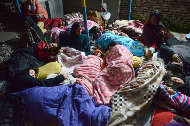 Nepalese residents sleep in an open area in Kathmandu on April 26, 2015, after an earthquake hit the Kathmandu Valley. Photo by Prakash Mathema/AFP/Getty Images