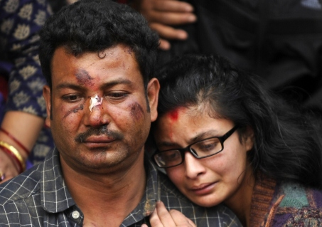 Nepalese residents mourn the death of a relative following an earthquake, at a mass cremation at Pashupatinath in Kathmandu on April 26, 2015. Photo by Prakash Mathema/AFP/Getty Images