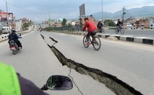 Cracks after the earthquake splitting the road in two.