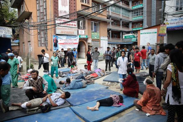 Injured people are tended to outside of hospital.