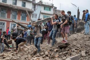 People assist in removing debris after earthquake