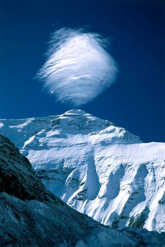 ROUND SPHERICAL CLOUD FORMS OVER MOUNTAIN PEAK