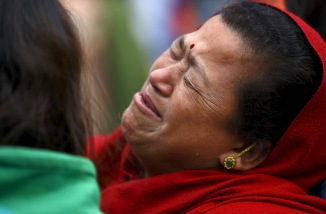 A woman mourns the death of a family member a day after an earthquake in Bhaktapur, Nepal April 26, 2015. Photo by Navesh Chitrakar/REUTERS