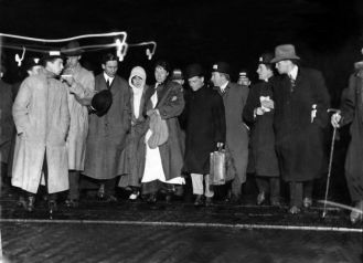 Survivors of the sinking of the RMS Titanic are interviewed by reporters as they come off the RMS Carpathia in New York on April 18, 1912.