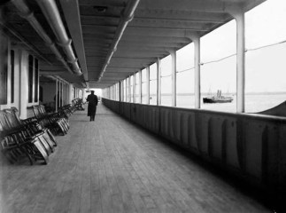 Titanic, having left Southampton is passing the Potugese RMSP Tagus. The Figure may be that of Cat. Smith.