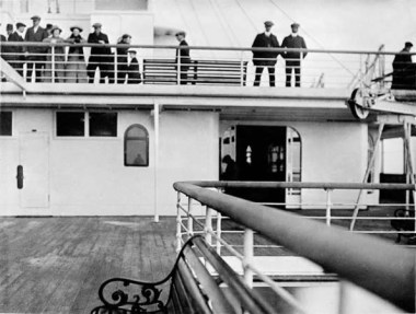 """Photographed from aft end of """""""" Deck. The sliding doors gave entry to the Starboard Verandah and thr Palm Court.y"""